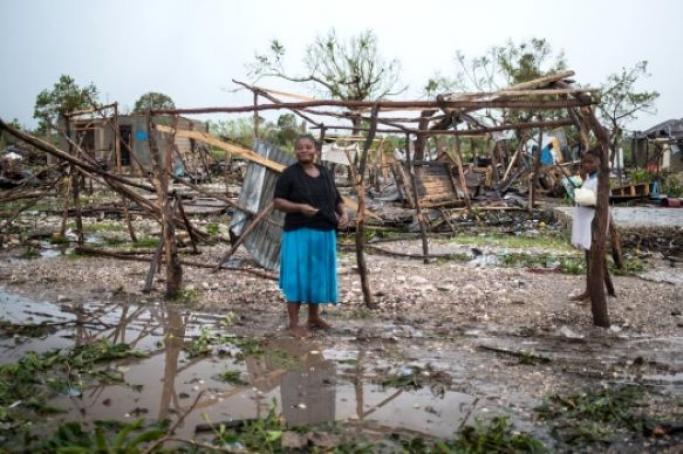 Woman in flood in Haiti