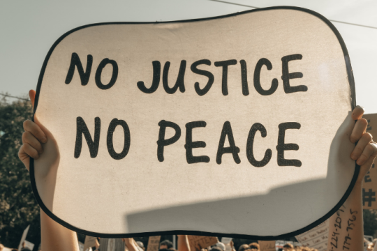 Sign that says No Justice No peace